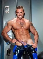Muscle athlete Jake Genesis in a locker room
