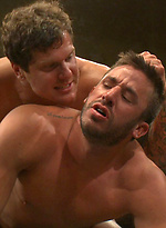Two big, beefy muscle men with huge cocks battle it out on the mat for ultimate control and the reward of fucking the loser's hot, meaty ass.