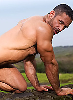Big muscle hunk shows his cock outdoors