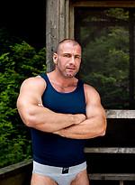 Mature bodybuilder posing naked