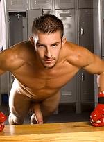 Mike Roberts posing in a locker room